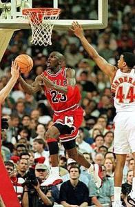 MJ pulled off this vintage under the layup Dr. J-like reverse in a way that only he could at that time....Oh yeah, and it was a three-point play as well.